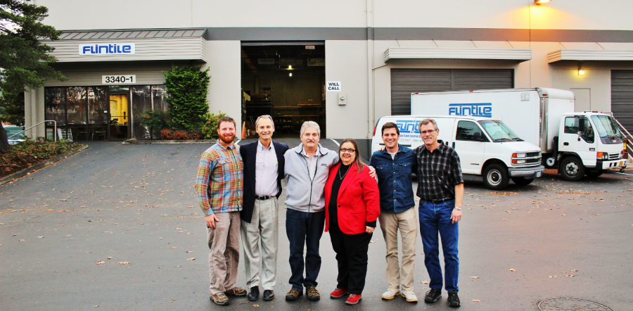The Flintile Inc. team standing together in the parking lot